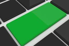 Black keyboard with green key Stock Image
