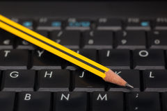 Black keyboard and pencil Royalty Free Stock Photography