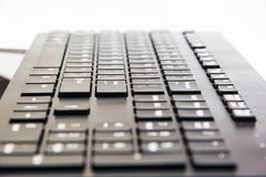 Black keyboard with perspective. Depth of field. White symbols. Slim keyboard Stock Photo