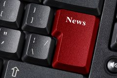 Black keyboard with red colored button. News inscription label Stock Photo