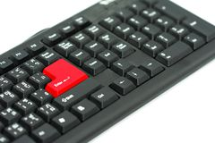 Black keyboard with red enter bottom. Isolated on white.  Concept Technology computer Royalty Free Stock Photo