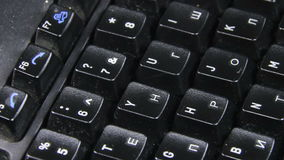 Black Keyboard Rotates. On the table. Close-up of keys from the keyboard letters. Full HD 1920 x 1080, 29,97fps stock footage