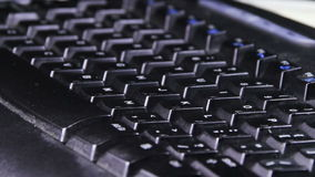 Black Keyboard Rotates. On the table. Close-up of keys from the keyboard letters. Full HD 1920 x 1080, 29,97fps stock video