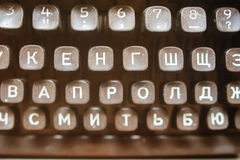 Black keyboard is vintage of a russian mechanical typewriter closeup. Black keyboard is vintage of a russian mechanical typewriter close-up Royalty Free Stock Photography