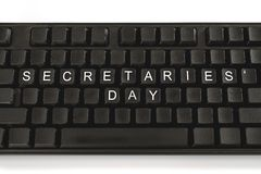 Black keyboard on white background. The inscription on the buttons - Secretaries Day. Minimal concept royalty free stock image