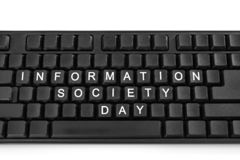 Black keyboard on white light background. The inscription on the buttons - Information Society Day stock photo