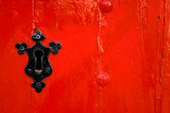 Black keyhole on red wooden door Royalty Free Stock Photography