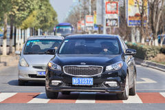 Black Kia K4 sedan on the road, Yiwu, China Stock Photos