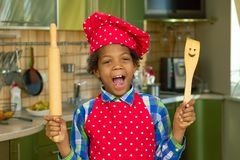 Black kid with cooking utensils. Boy in the kitchen. Basic cooking skills Royalty Free Stock Photo
