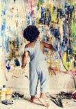 Black kid enjoying his painting royalty free stock photos
