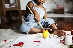 Black kid enjoying his painting stock photos