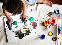 Black kid enjoying his painting stock photo