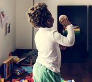 Black kid throwing baseball ball royalty free stock photography