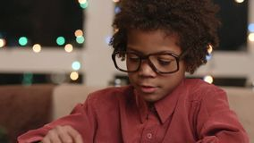 Black kid typing on keyboard.