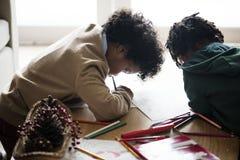 Black kids enjoying the coloring book Stock Image