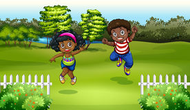 Black kids near the trees Royalty Free Stock Images