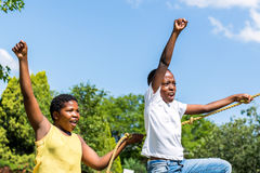 Black kids shouting together in playground. Royalty Free Stock Images