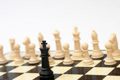 Black king against white figures in the chess Stock Photo