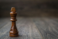 Black King, Chess Piece on a Wooden Table Stock Photo
