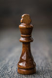 Black King, Chess Piece on a Wooden Table Royalty Free Stock Photos