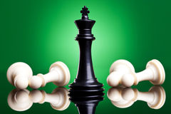 Black king defeates white pawns Stock Images