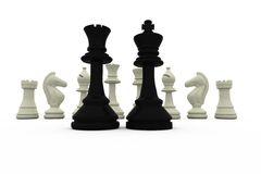 Black king and queen standing in front of white pieces Stock Photo