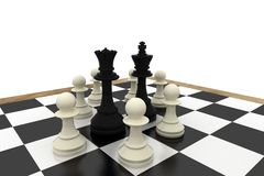 Black king and queen surrounded by white pawns Stock Photo