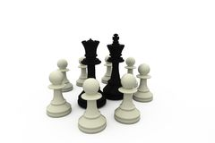 Black king and queen surrounded by white pieces Stock Images