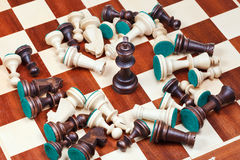 Black king and scattered chess pieces Royalty Free Stock Photos