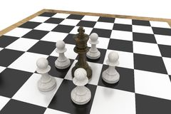 Black king surrounded by white pawns Royalty Free Stock Images