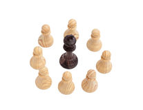 Black King surrounded by white pawns Royalty Free Stock Photo