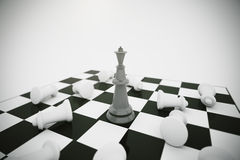 Black king and white chess pieces losers Royalty Free Stock Photo