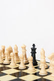 Black king with white figures in the chess Royalty Free Stock Photos