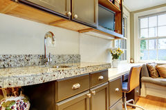 Black kitchen cabinets with marble counter top. Wood kitchen black cabinets with marble counter top and steel faucet royalty free stock images