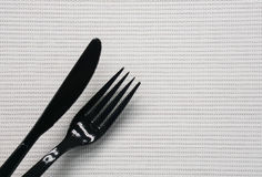 Black knife and fork. Close up black knife and fork stock photos