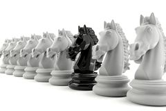 Black knight chess among white knight chess Royalty Free Stock Photo