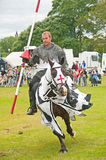 Black Knight rides by at Tain Stock Photography