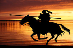 Black Knight and sunset. Black silhouette of  Knight on sunset background Stock Images