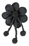 Black knitted fabric flower Stock Photography