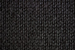 Black knitted textured background. Studio shot Royalty Free Stock Photo