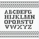 Black knitting alphabet on white background Stock Photos