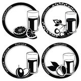 Black labels with juice in glass and fruits Stock Image