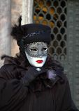Black Lace. A woman dressed for Mardi Gras Carnivale in Venice Italy,St Marks Square Royalty Free Stock Image