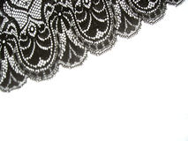 Black lace. Shadow of black lace on white background Stock Photo