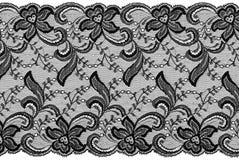 Black lace. Flowered  black lace on white background Royalty Free Stock Image