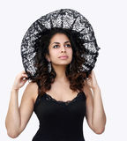 Black lace beauty. Beautiful woman in black lace hat Royalty Free Stock Image