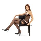Black lace brunette in chair with mask Royalty Free Stock Photography
