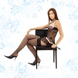 Black lace brunette in chair with mask Royalty Free Stock Image