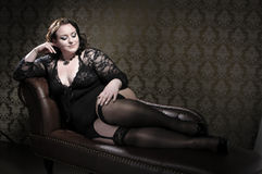 Black lace on chesterfield sofa Stock Photos