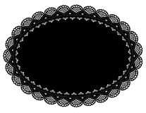 Black Lace Doily Place Mat. VINTAGE LACE DOILY PLACE MAT, antique rose pattern, black oval on white background for setting table, home decorating, scrapbooks Stock Photo
